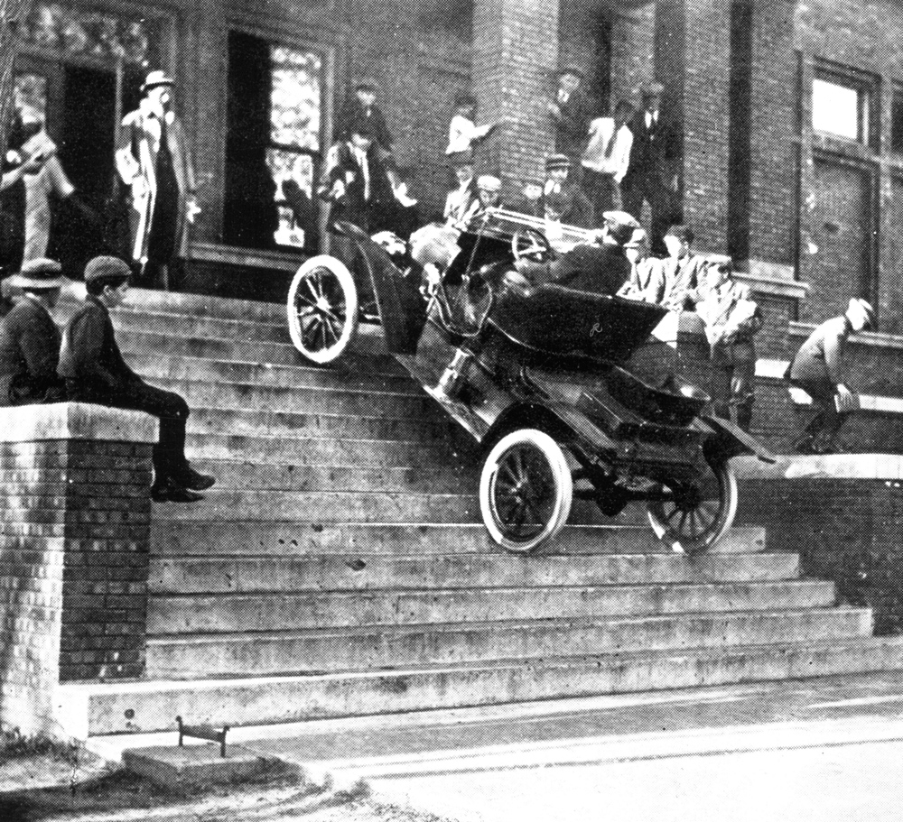 1911 model t runabout driving up steps of ymca. Cars Review. Best American Auto & Cars Review
