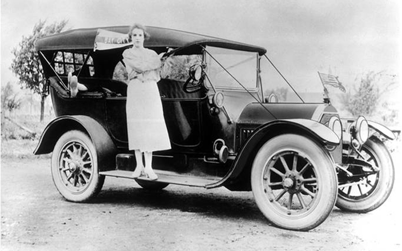 1913 Cadillac Touring Car With Women Standing On Running Board
