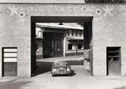 The first Ferrari built, 125S, on the entrance of the factory in 1947