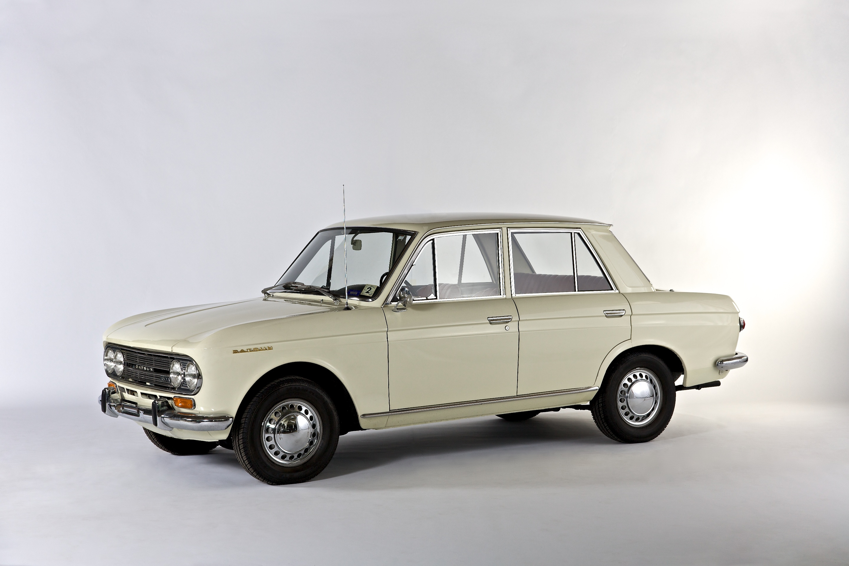 "The Datsun 411 was produced from 1965 to 1967 and featured a body designed by Italy's famed Pininfarina studio. It shared its 96-horsepower 1.6-liter inline 4-cylinder engine with the sporty Datsun 1600 Roadster and featured standard front disc brakes and 13-inch wheels and tires. Car and Driver magazine, in its May 1967 review said, ""From what we were able to deduce, it handles creditably well, though its makers have a lot to learn about the subtleties of shock absorber calibration."""